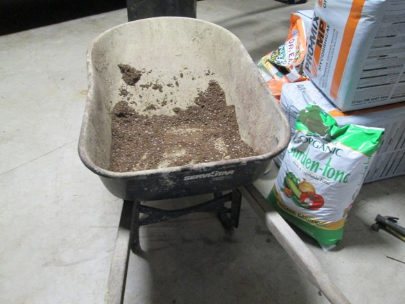 We mixed the Pro-Mix Organik potting mix with a pit of Gard-N-Tone organic soil amendments for an added kick.
