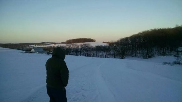 Dad surveys the fields and wishes for less snow.
